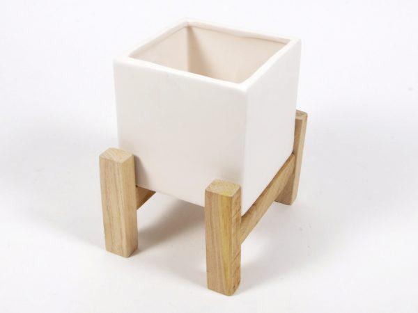 Vaso in ceramica con base in legno